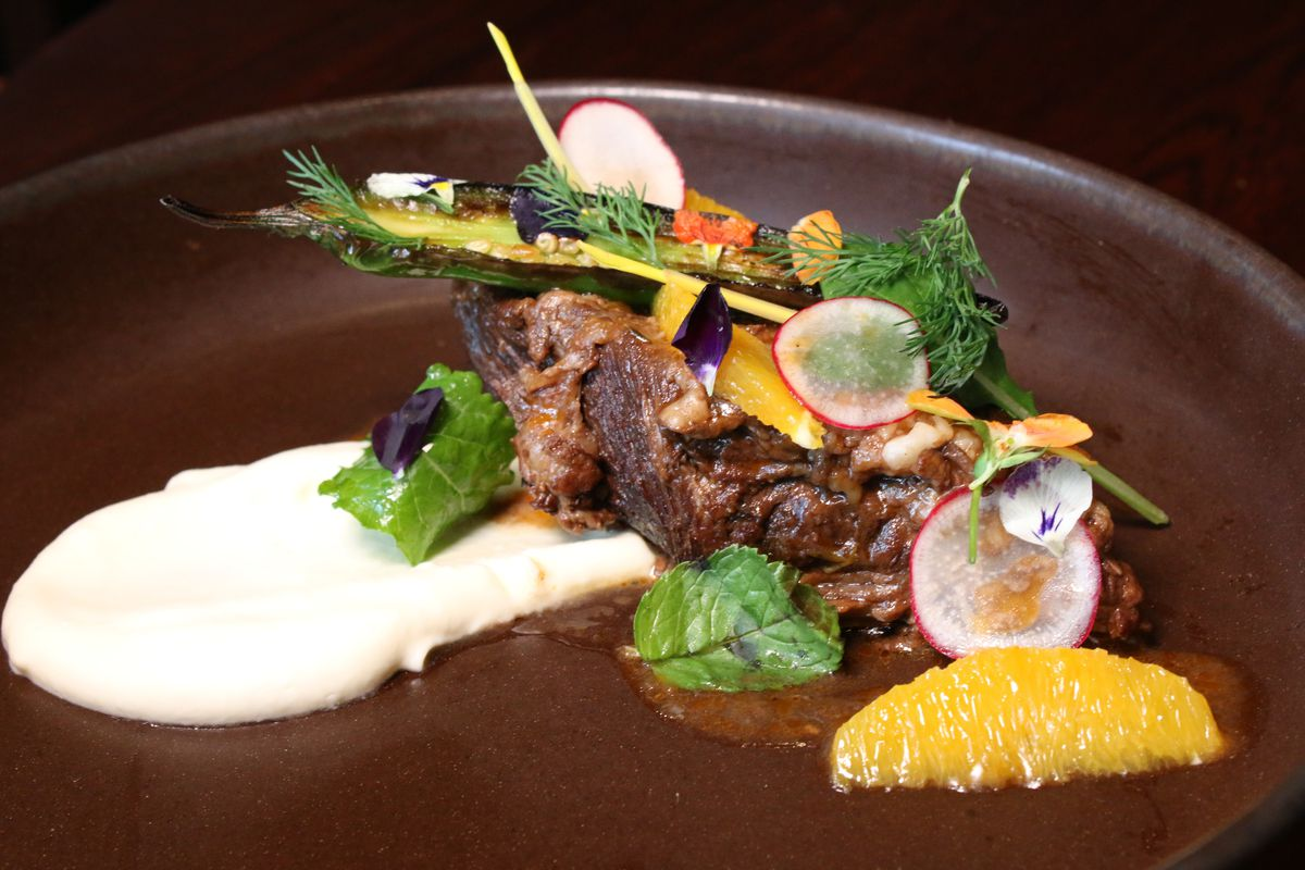 Braised short with herbs plated over puree