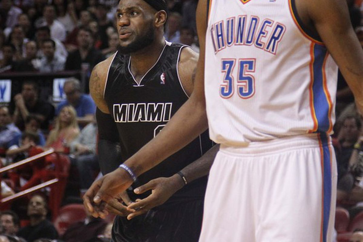 April 4, 2012; Miami, FL, USA; Miami Heat small forward LeBron James (left) and Oklahoma City Thunder small forward Kevin Durant (35) in the fourth period at the American Airlines Arena. Mandatory Credit: Robert Mayer-US PRESSWIRE