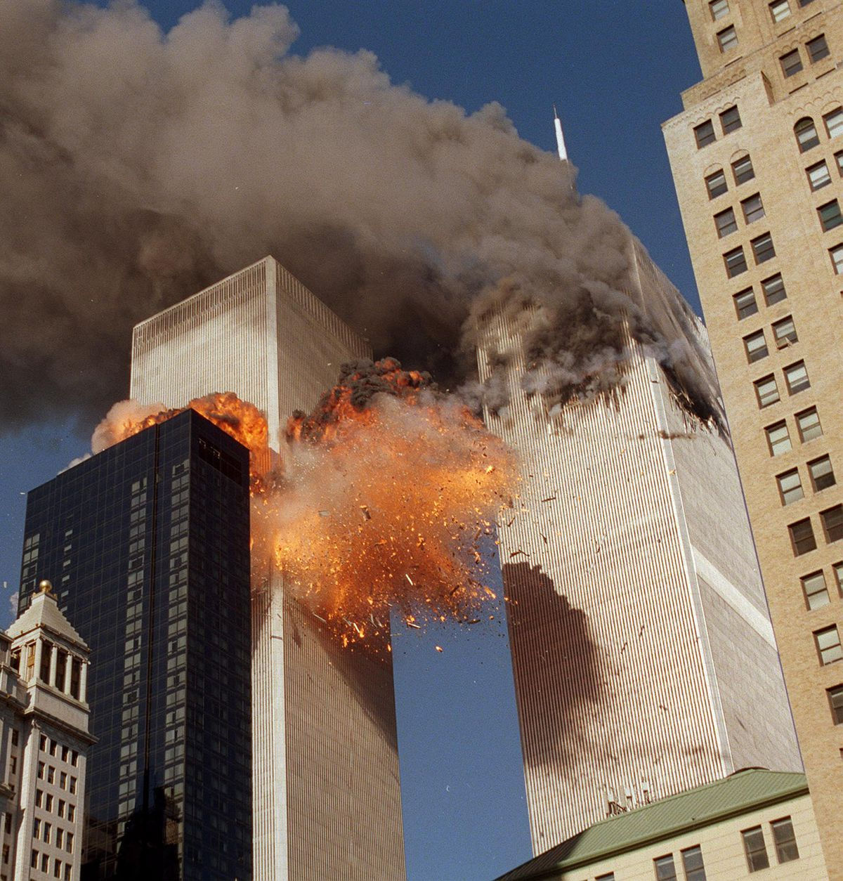 Smoke billows from one of the towers of the World Trade Center as flames and debris explode from the second tower in this Sept. 11, 2001 file photo in New York.