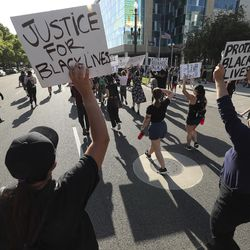 Protesters decrying the police shooting of Bernardo Palacios-Carbajal gather in the street in front of the district attorney's office in Salt Lake City on Thursday, July 9, 2020.