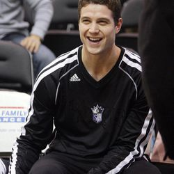 Jimmer Fredette awaits the start of the Friday, Nov. 23, 2012, game between the Sacramento Kings and Utah Jazz in Salt Lake City. Fredette, a former BYU standout, is suing Utah-based clothing company Black Clover Enterprises for allegedly failing to pay him and using his name and likeness for profit.
