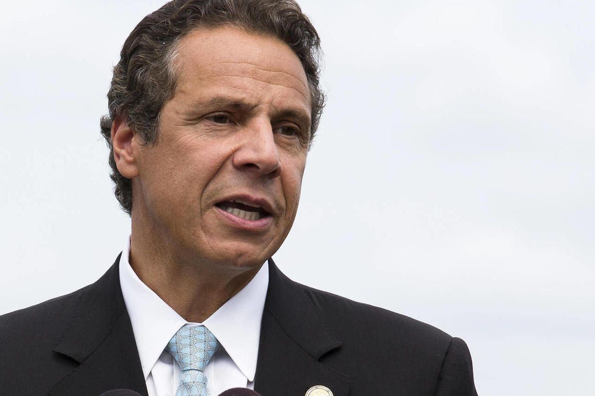 """FILE - In this Aug. 20, 2012 file photo, New York Gov. Andrew Cuomo speaks in Piermont, N.Y. Cuomo says the race for the White House is a """"gut check election for America"""" and offering a stinging indictment of the Republican presidential ticket on the side"""