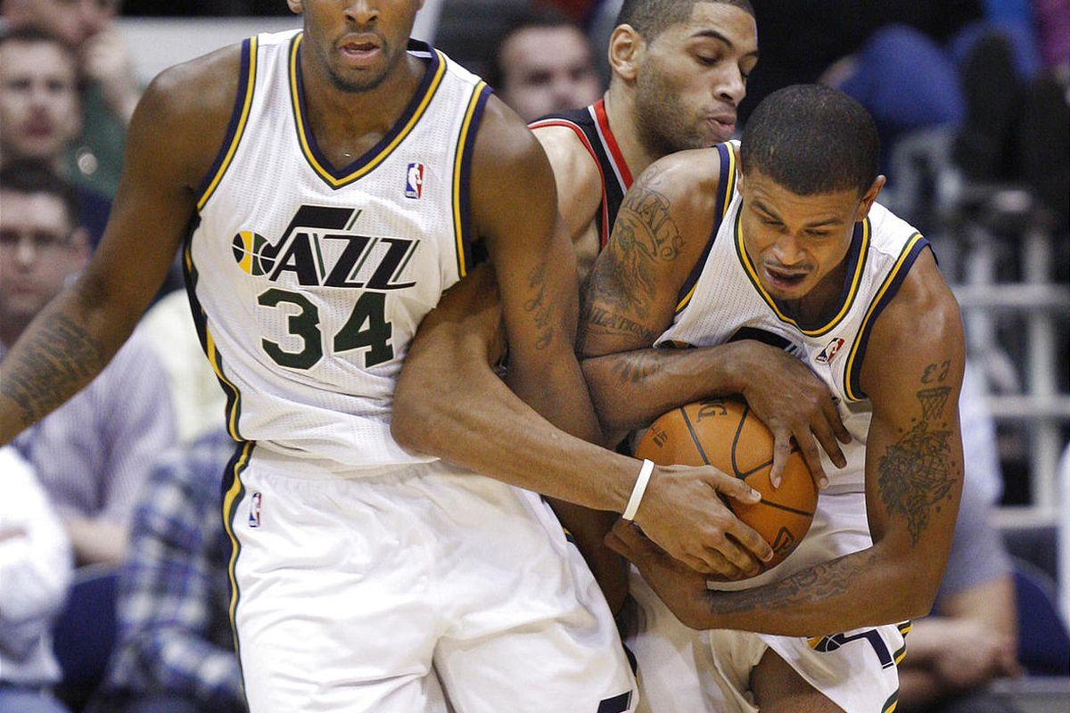 Utah's C. J. Miles (34) and Earl Watson hang onto the ball as Portland's Nicolas Batum get tangled with them as the Utah Jazz and the Portland Trail Blazers play NBA basketball  Monday, Jan. 30, 2012, in Salt Lake City, Utah.