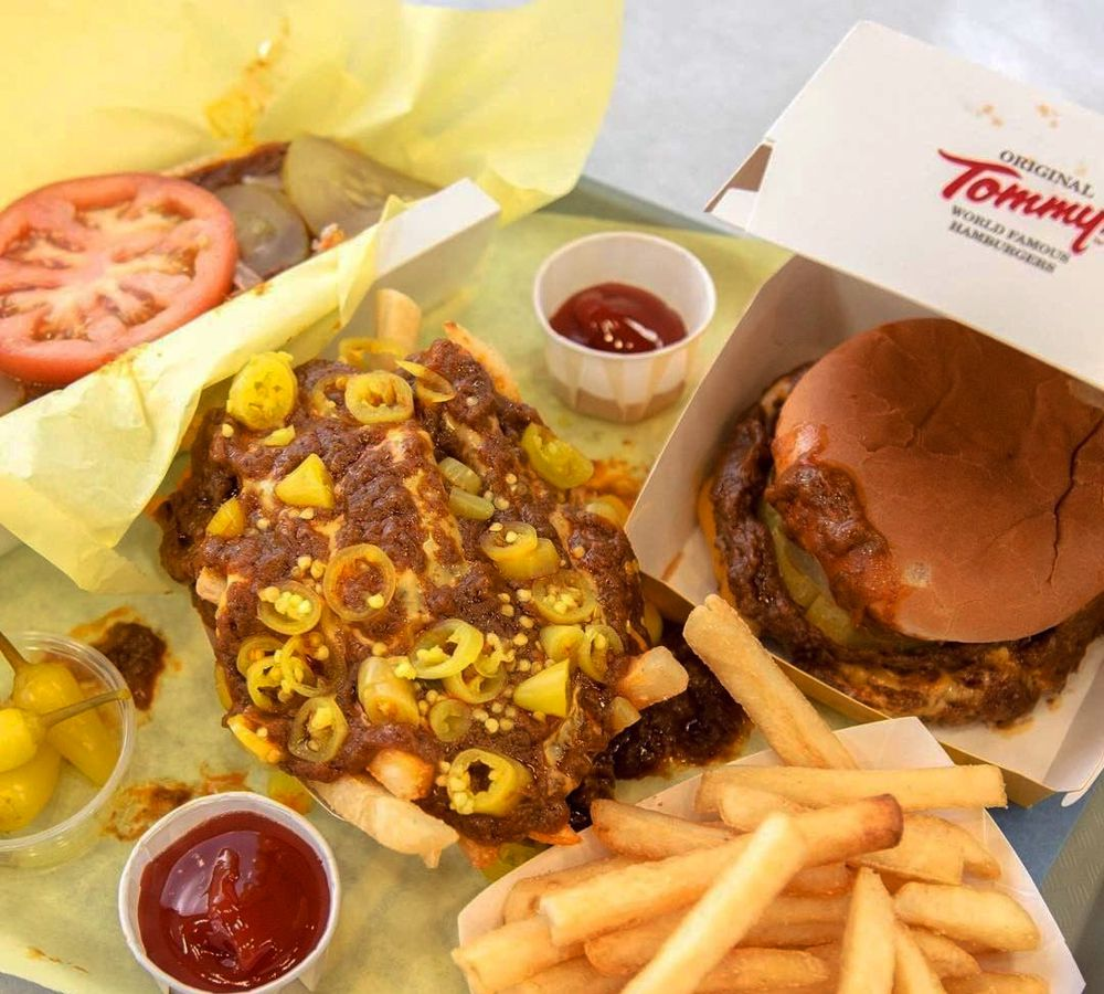 The famous chili burger and fries combo on the delivery menu at Original Tommy's.