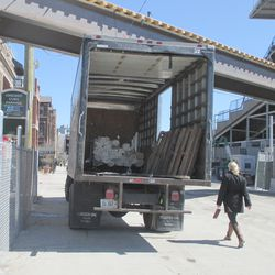 Delivery truck with rolls of canvas for the parking tent -