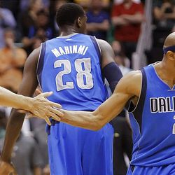Dallas Mavericks guard Jason Kidd (2) and teammate Dallas Mavericks guard Vince Carter (25) celebrate a three point shot to force a second overtime as the Utah Jazz and the Dallas Mavericks play Monday, April 16, 2012 in Salt Lake City.