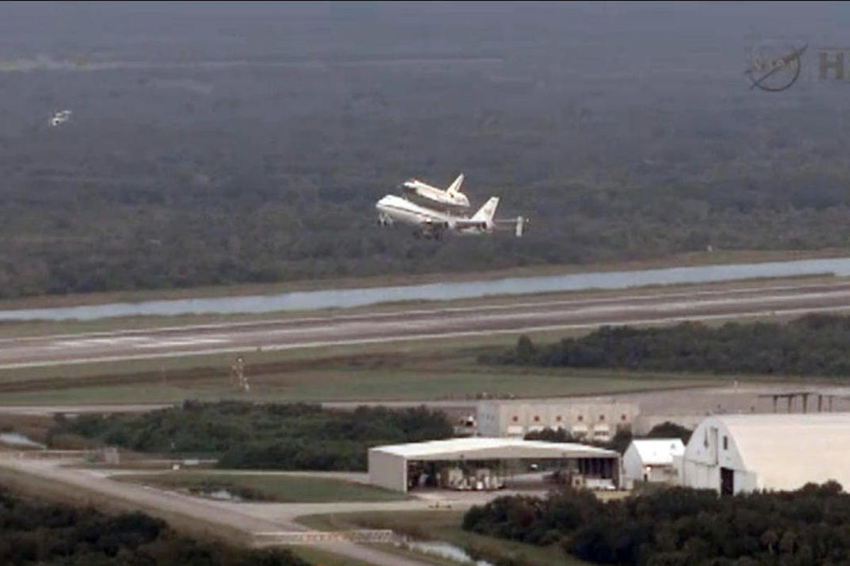 This framegrab image provided by NASA TV shows space shuttle Endeavour atop NASA's Shuttle Carrier Aircraft, or SCA, at the Shuttle Landing Facility in the early morning hours at NASA's Kennedy Space Center on Wednesday, Sept. 19, 2012 in Cape Canaveral,