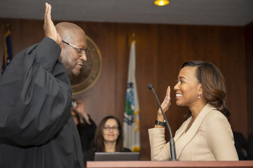 Metropolitan Water Reclamation District Commissioner Kari K. Steele is sworn in for her second six-year term by Judge P. Scott Neville, on Dec. 4, 2018. On Jan. 10, her colleagues unanimously elected her President. | Photo by Dan Wendt