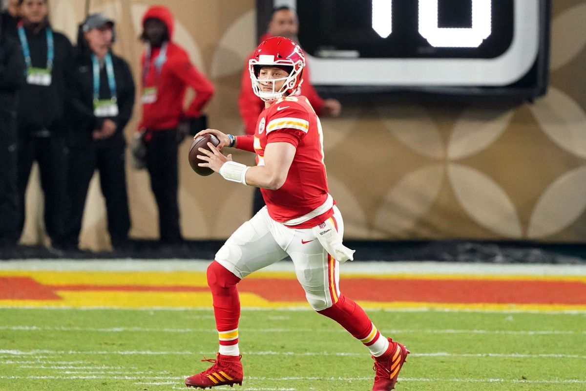 Kansas City Chiefs quarterback Patrick Mahomes looks to pass the ball during the first quarter in Super Bowl LIV against the San Francisco 49ers at Hard Rock Stadium.
