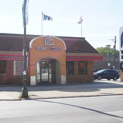 A view of the Taco Bell on Addison Street, with the Cubs cap visible on the restaurant sign