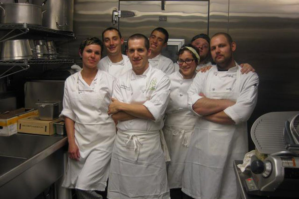 James Rigato (center) With The Root Staff.