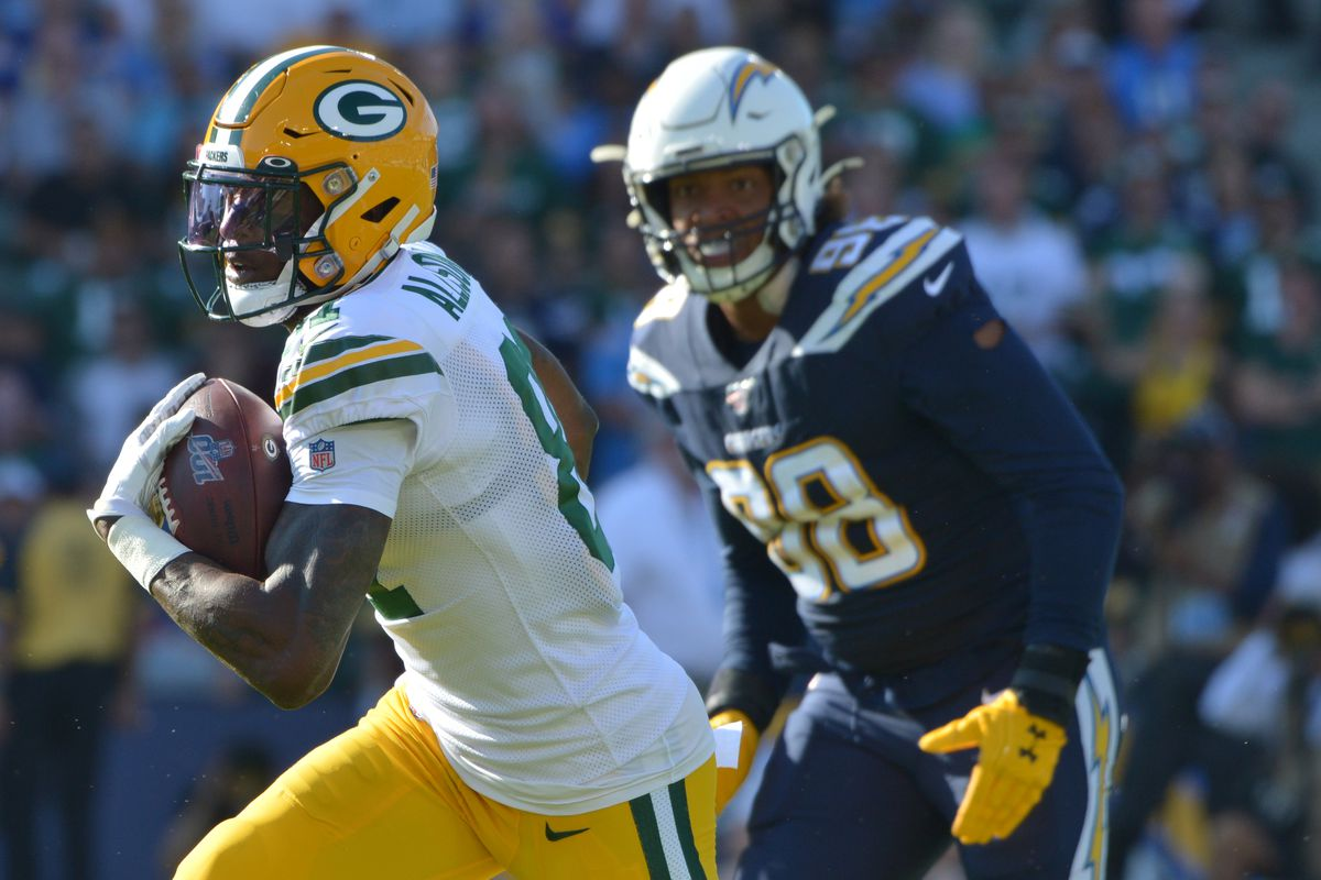 Green Bay Packers wide receiver Geronimo Allison is defended by Los Angeles Chargers defensive end Isaac Rochell during the second quarter at Dignity Health Sports Park.