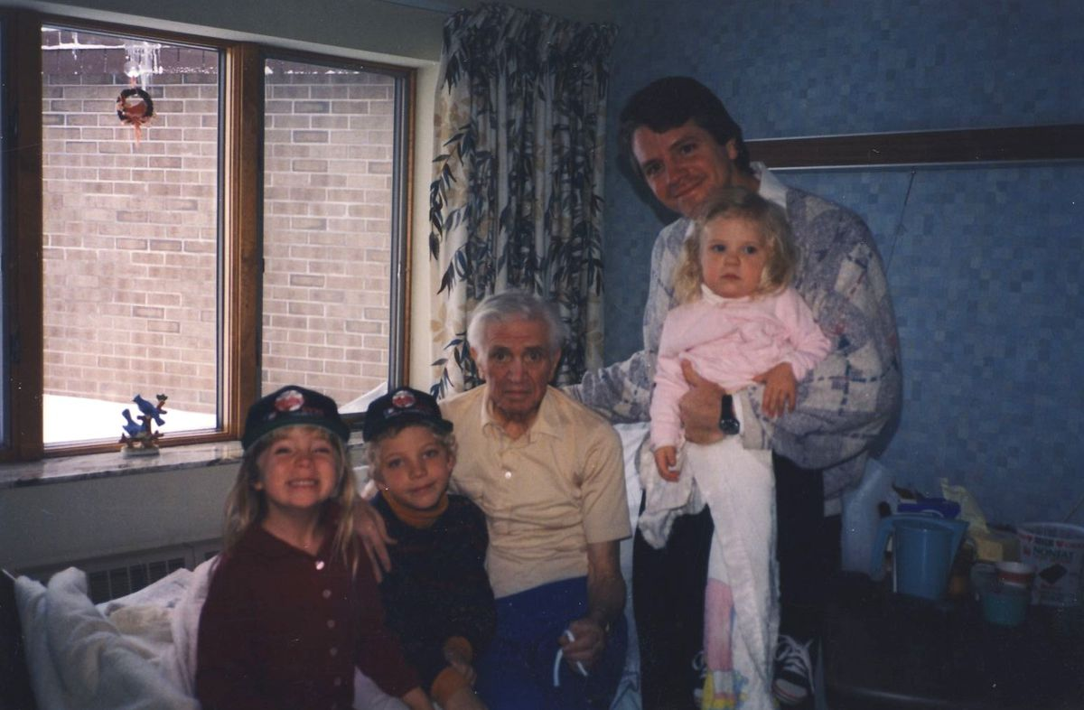 Me wearing a 1991 Twins World Series Champions hat with my family.