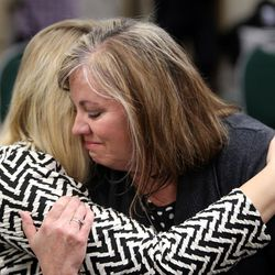 Amber Baum, who lost her daughter to a heroin overdose, hugs Michelle Bills, who lost her son to an overdose, during a press conference to launch a new campaign, Stop the Opidemic, at the Utah Department of Health in Salt Lake City on Wednesday, Jan. 25, 2017.
