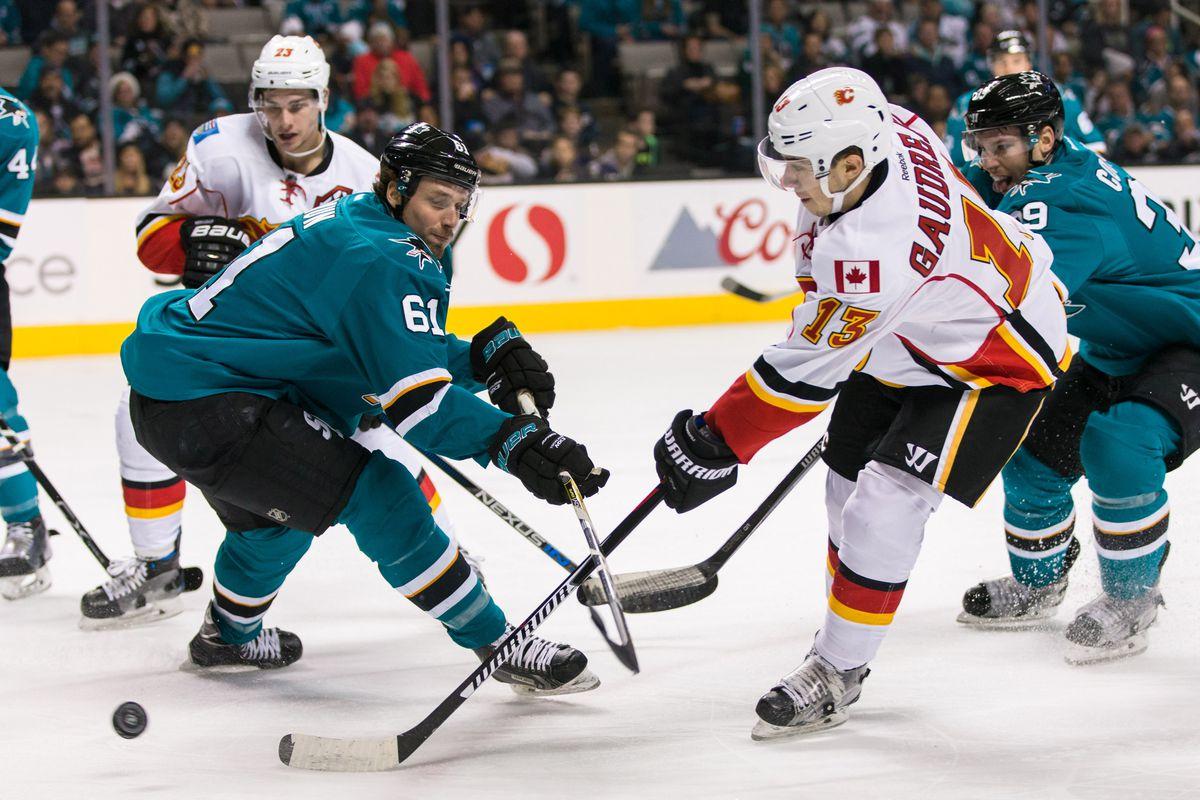Dec 20, 2016; San Jose, CA, USA; Calgary Flames left wing Johnny Gaudreau (13) shoots past San Jose Sharks defenseman Justin Braun (61) in the second period at SAP Center at San Jose.