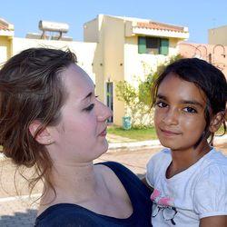 Catriona Franck, a volunteer from Switzerland, holds Cidra Al-Hamdan, 8, from Damascus, Syria, at the Kyllini refugee camp in Myrsini, Greece, July11, 2016.
