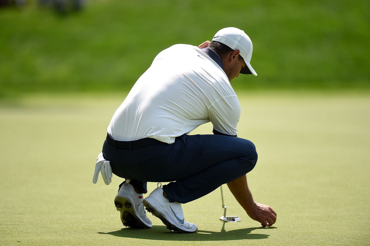 Brooks Koepka lines up a putt on the seventh hole during the third round of the Travelers Championship at TPC River Highlands on June 22, 2019 in Cromwell, Connecticut.