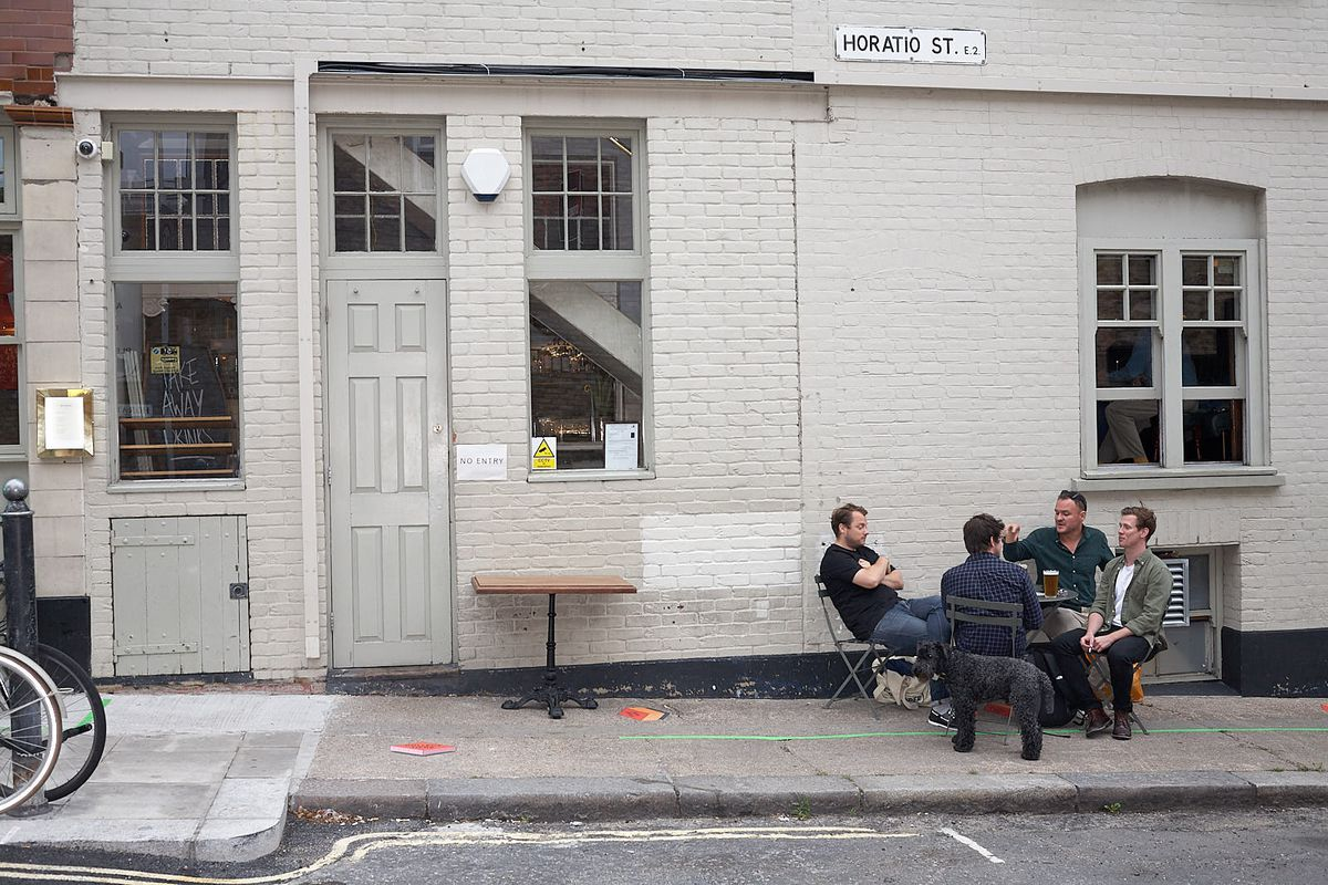 Socially distanced outdoor drinkers at the Marksman on Hackney Road, east London