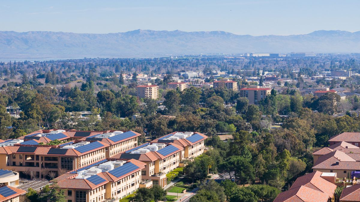 An aerial photo of rooftops and trees, facing towards Palo Alto, Stanford and the towns of south San Francisco Bay Area.