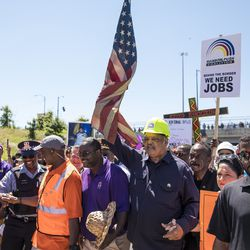 The Rev. Jesse Jackson marches alongside the Rev. Michael Pfleger.   Ashlee Rezin/Sun-Times
