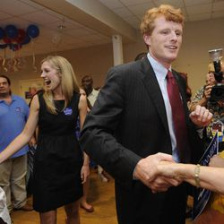Joseph Kennedy III, son of former U.S. Rep. Joseph P. Kennedy II and grandson of the late Robert F. Kennedy, right, and his fiance Lauren Anne Birchfield, left, greet supporters during a watch party in Taunton, Mass., Thursday, Sept. 6, 2012. The 31-year-old Kennedy is vying for the House seat being vacated by Democratic U.S. Rep. Barney Frank. Kennedy won the Democratic primary for the Massachusetts Fourth Congressional District Thursday.