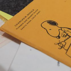 Envelopes sent to Amy Schulz Johnson, daughter of Peanuts' creator Charles Schulz, while she was serving an LDS mission in England. Johnson talked about her father during an interview at her home in Alpine Wednesday, Oct. 28, 2015.