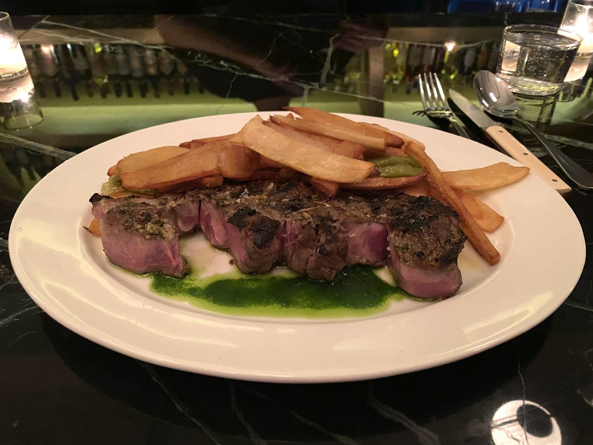 The double loin cross at Ernesto's, cut from a lamb aged 18-24 months, sits underneath a pile of fries and roasted green peppers