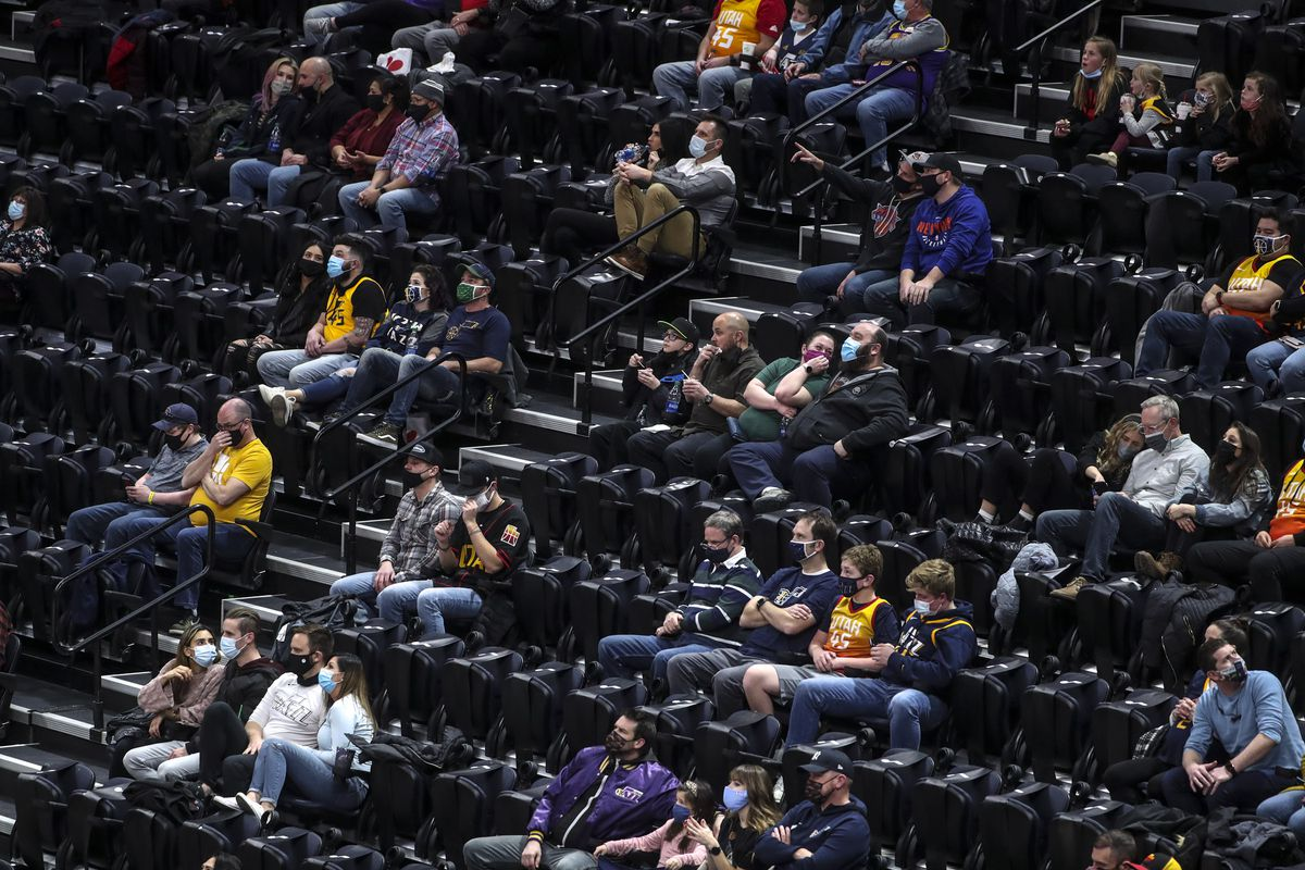 Fans social distance as they watch the New York Knicks and Utah Jazz NBA basketball game at Vivint Smart Home Arena in Salt Lake City on Tuesday, Jan. 26, 2021.