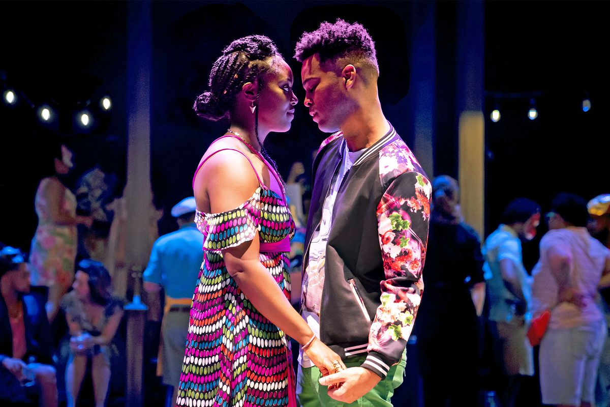 """Juliet (BrittanyBellizeare) and Romeo (Edgar Miguel Sanchez) risk everything for love in Chicago Shakespeare Theater's production of Shakespeare's""""Romeo and Juliet."""""""