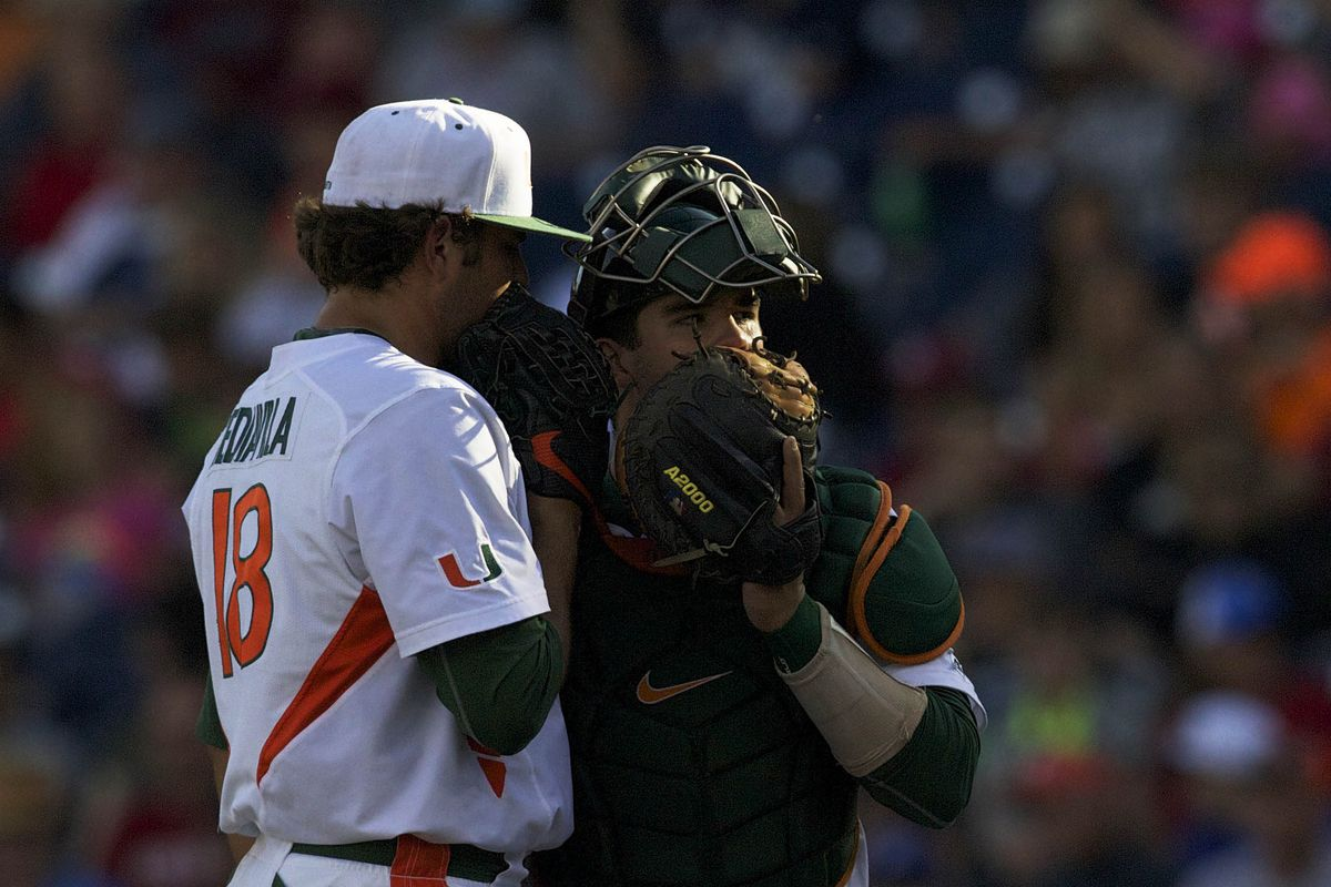 Michael Mediavilla discusses with Miami's catcher on the mound.