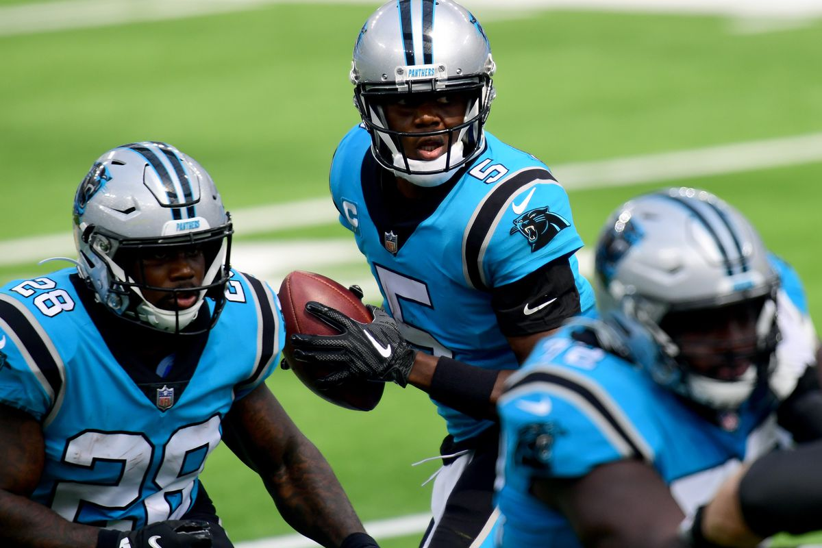 Teddy Bridgewater of the Carolina Panthers drops back to pass behind Mike Davis during the first quarter against the Los Angeles Chargers behind at SoFi Stadium on September 27, 2020 in Inglewood, California.