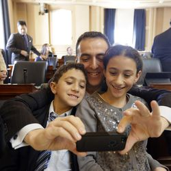 Marcus Simon, a member of the Virginia House of Delegates, takes a selfie with his children Zach and Emily, during opening ceremonies of the 2014 General Assembly at the Capitol in Richmond, Va., on Jan. 8.