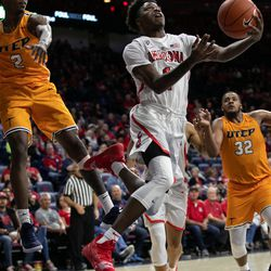 Arizona's Devonaire Doutrive, center, lays the ball in up-and-under during the Arizona-University of Texas El Paso game in McKale Center on November 14 in Tucson, Ariz.