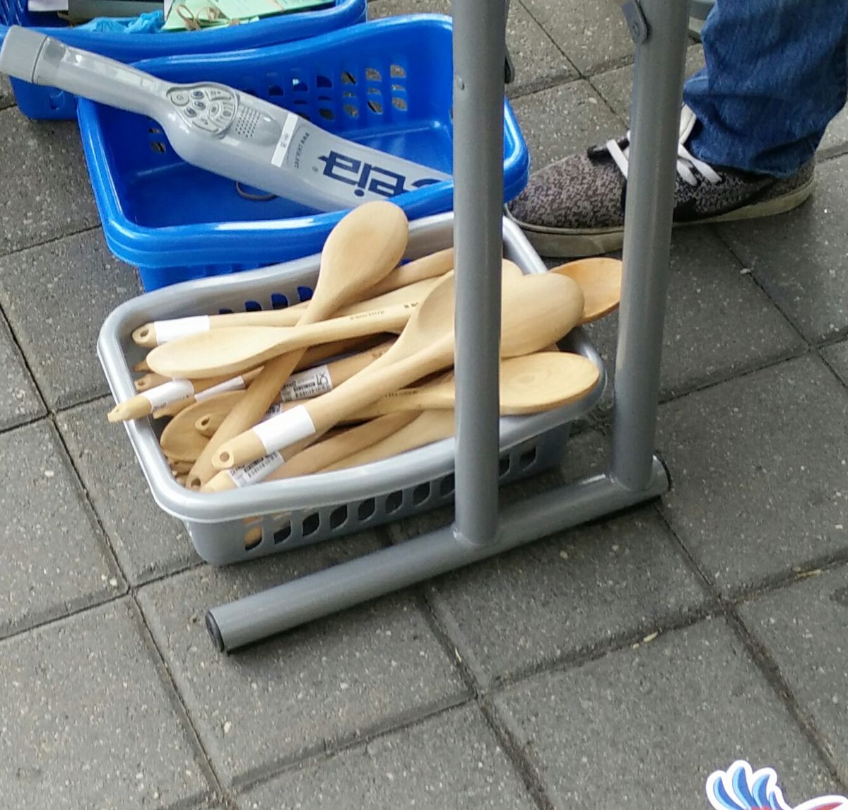 Small basket filled with wooden spoons