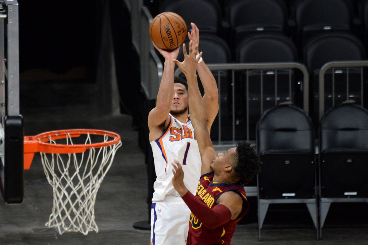 Phoenix Suns guard Devin Booker (1) shoots over Cleveland Cavaliers guard Isaac Okoro (35) during the second half at Phoenix Suns Arena.