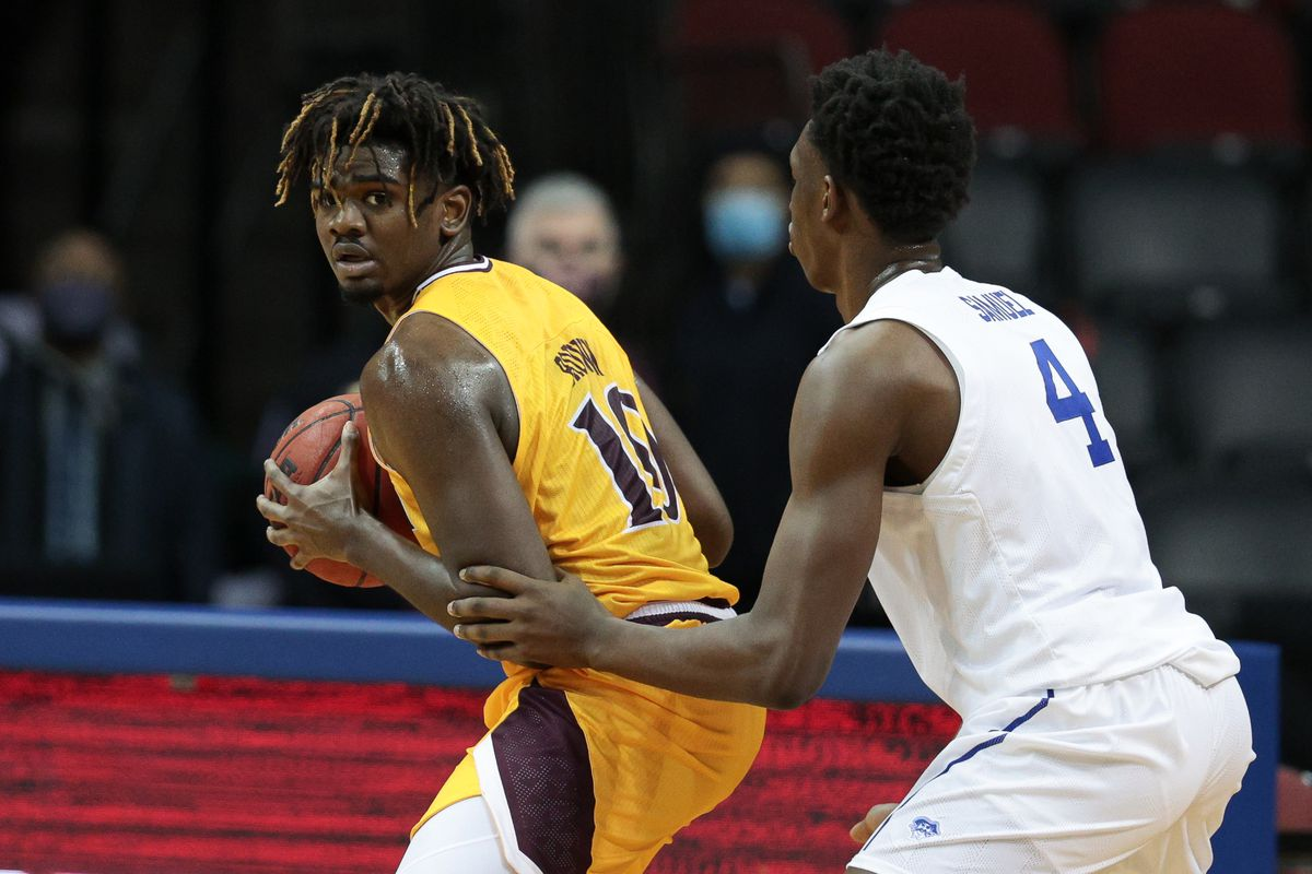 Iona Gaels forward Robert Brown shields the ball from Seton Hall Pirates forward Tyrese Samuel during the second half at Prudential Center.