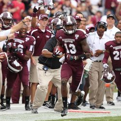 Mississippi State defensive back Johnthan Banks (13) runs after intercepting a pass in the first half of an NCAA college football game against Auburn Saturday, Sept. 8, 2012 in Starkville, Miss.