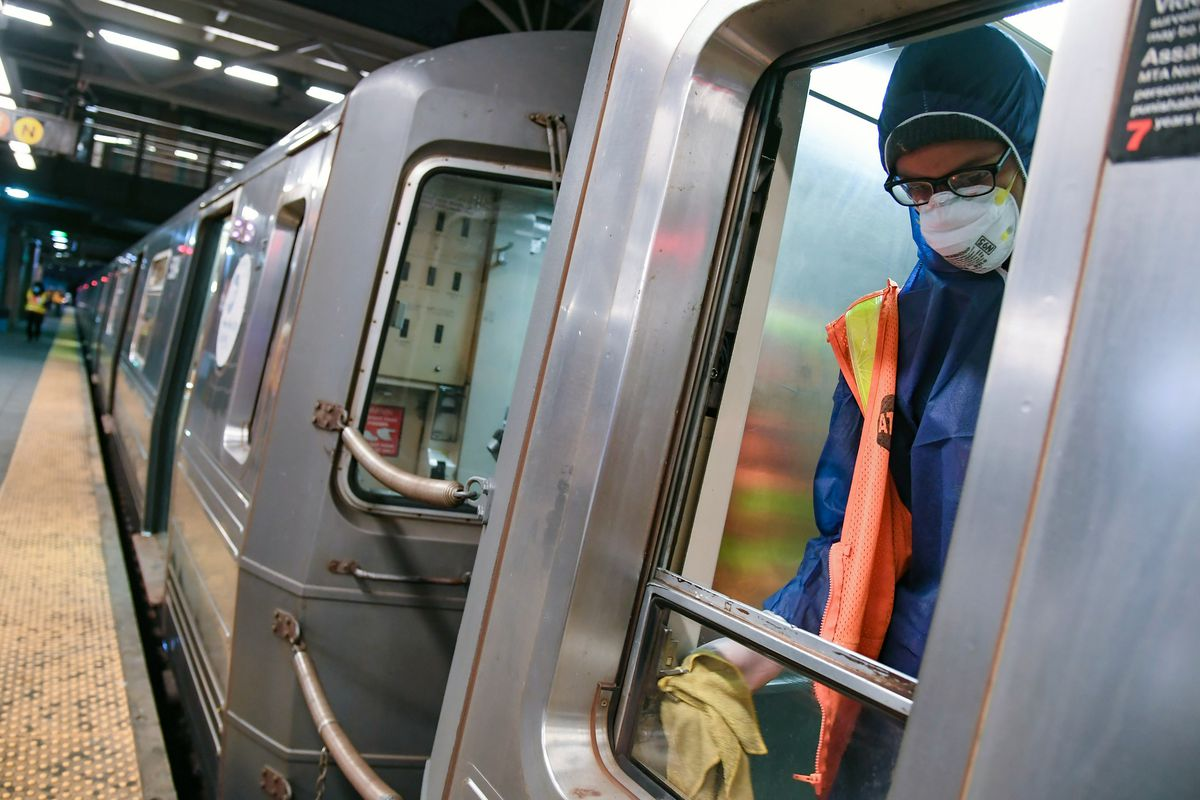 An MTA worker cleans a train at the Coney Island terminal in Brooklyn, on May 7, 2020.