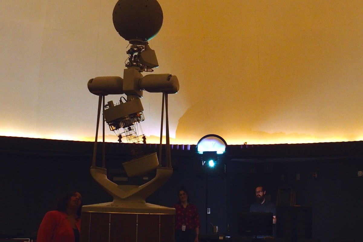 Principal Tisha Durrah, left, inspects a part of the planetarium that projects constellations and planets onto the large white dome screen at Craigmont High School.
