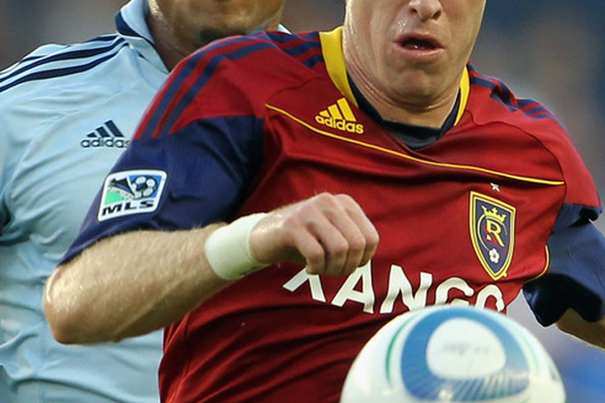 KANSAS CITY, KS - AUGUST 03:  Teal Bunbury #9 of Sporting Kansas City chases Nat Borchers #6 of Real Salt Lake and the ball during the game on August 3, 2011 at LiveStrong Sporting Park in Kansas City, Kansas.  (Photo by Jamie Squire/Getty Images)