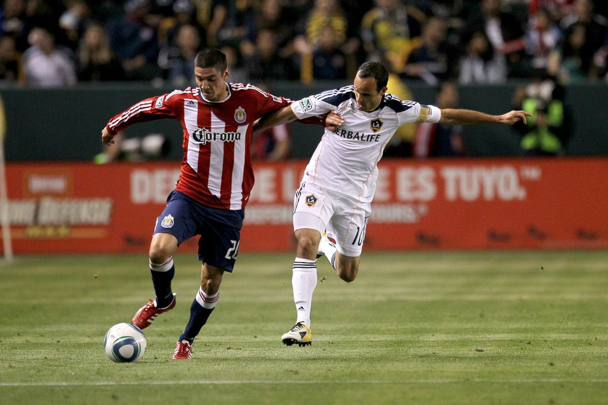 CARSON, CA - MAY 21:  A.J. DeLaGarza #20 of Chivas USA fights for the ball with Landon Donovan #10 of the Los Angeles Galaxy at The Home Depot Center on May 21, 2011 in Carson, California.  The Galaxy won 1-0.  (Photo by Stephen Dunn/Getty Images)
