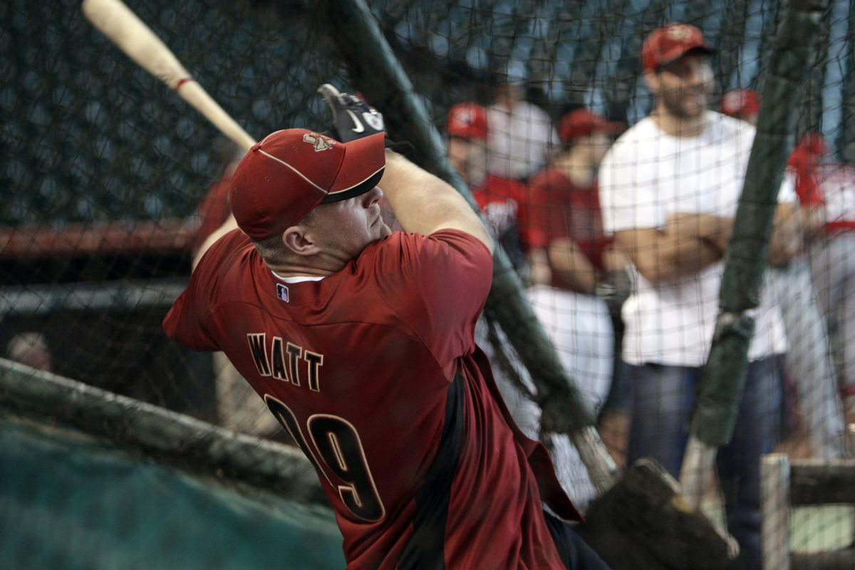 HOUSTON - JULY 19:  J.J. Watt, first round pick of the Houston Texans in the 2011 NFL draft, proves to be a better hitter than all Astros but Jose Altuve.  (Photo by Bob Levey/Getty Images)