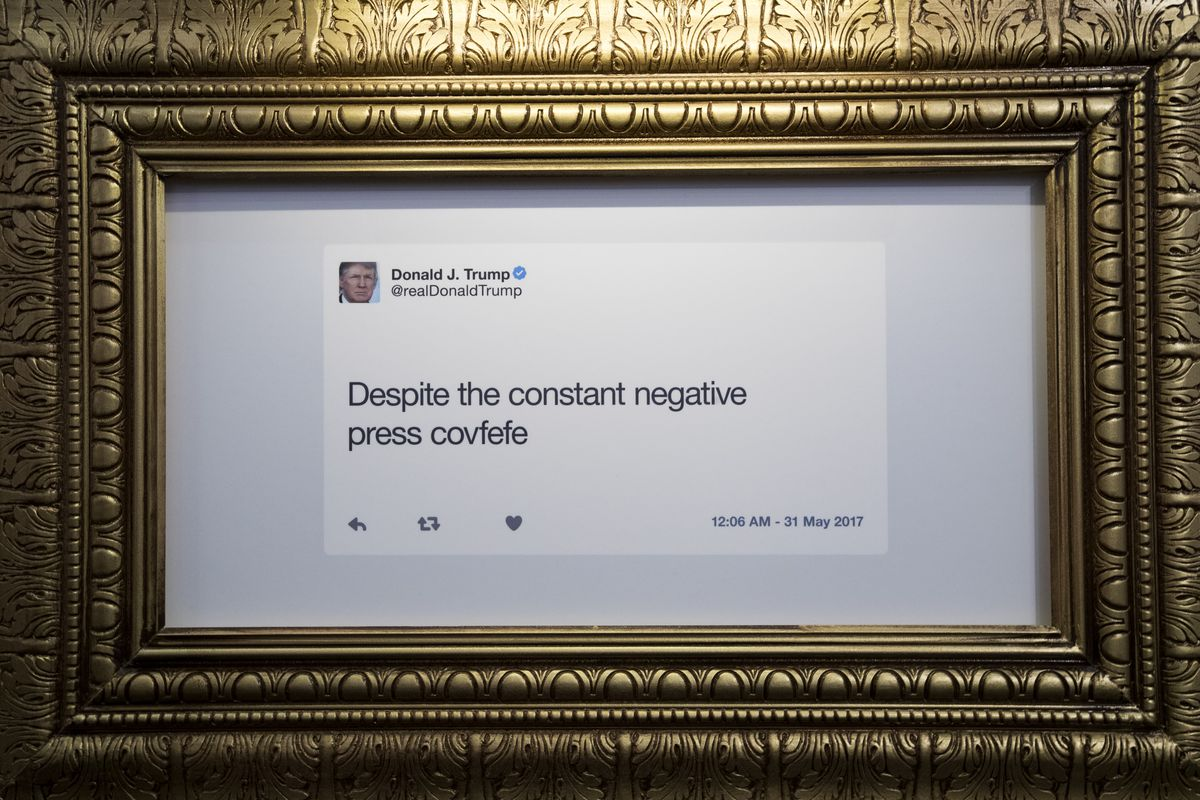 """A framed picture of a President Trump tweet reads: """"Despite the constant negative press covfefe"""""""