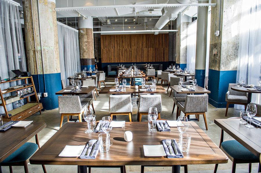 the main dining area at the mercury inside ponce city market - Midcentury Restaurant Interior