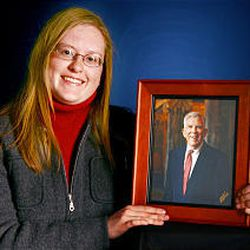 Hodgson holds a picture of her grandfather, Bill Berge, who inspired her winning essay.
