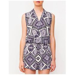Perfect for an shorts-friendly office or a bridal/baby shower, this romper's modest cut allows for the fun print to take center stage. Keep your accessories in a black-and-white palette, add delicate jewelry, a sleek chignon, and top it all off with a cle