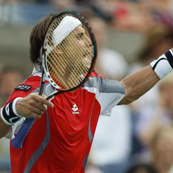 Spain's David Ferrer reacts while playing Serbia's Janko Tipsarevic in the quarterfinals during the 2012 US Open tennis tournament,  Thursday, Sept. 6, 2012, in New York.