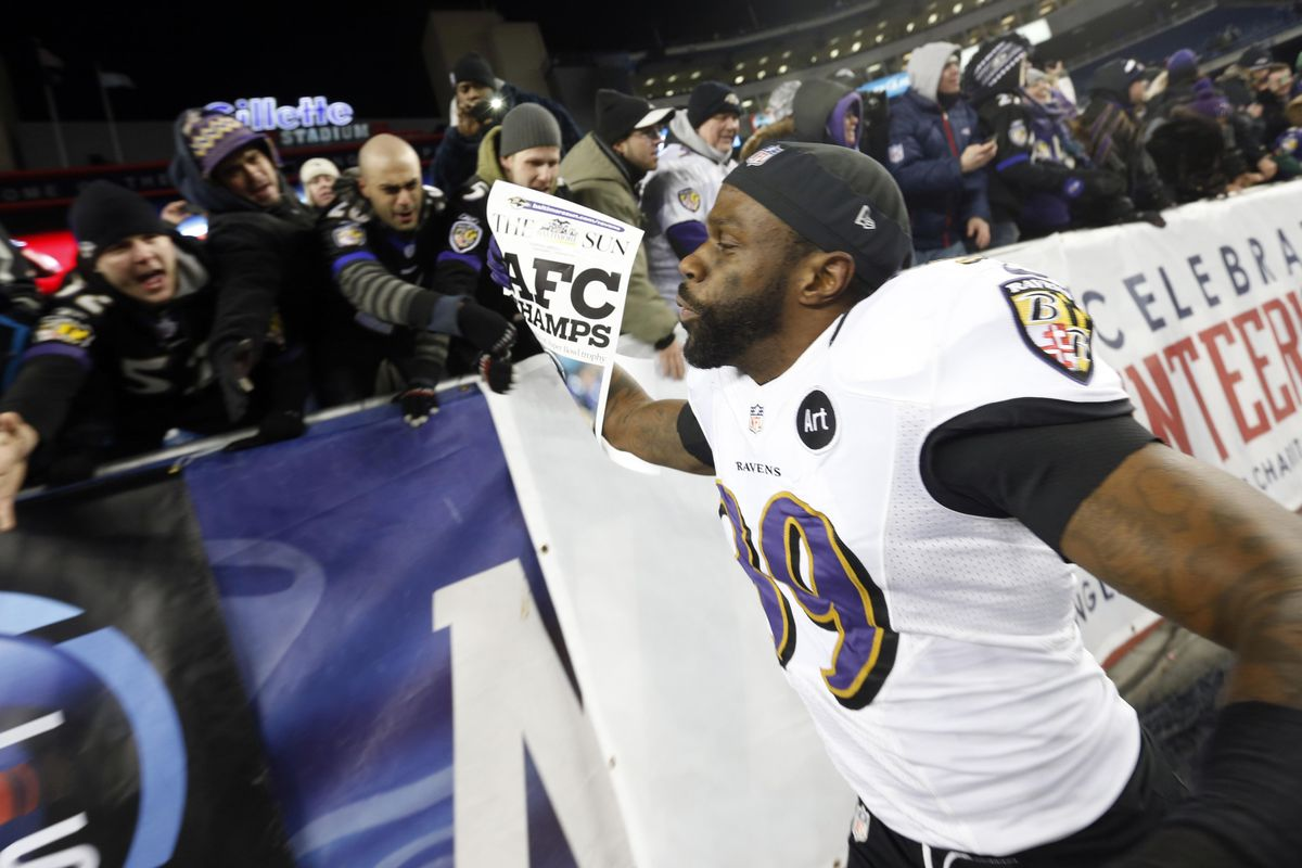 Ravens' CB Chris Johnson gives fans high-fives after the win against the Patriots in the AFC Championship Game.