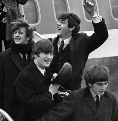 <em>The Beatles arrive in America, almost exactly 50 years before Baez arrives in the majors.</em>