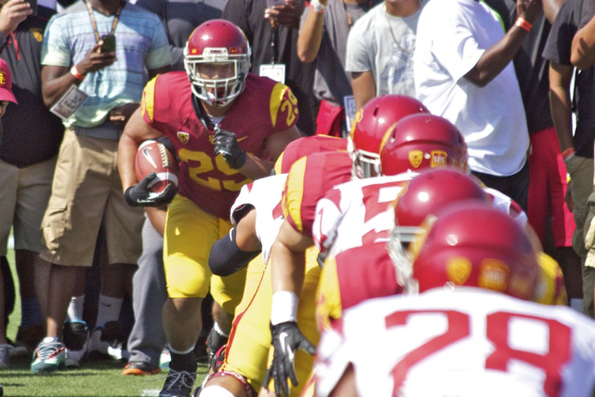 Ty Isaac runs the gauntlet at USC's Spring Game.